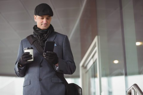 The classic winter business attire - mens scarf, coat, hat, and gloves.